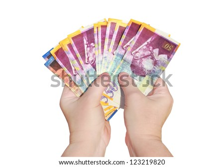 Hands keep banknotes (Shekel israeli) isolated on a white background.