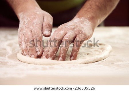 hands knead the dough ( Bot Mi ) for pizza making