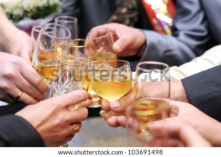 hands make cheers with glasses of champagne