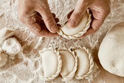 hands make dumplings, hands kneading dough, baker, the Baker's hands, dough, hands in the flour, dumplings, handmade dumplings, ravioli