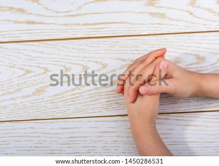 Hands making a gesture on a wooden background #1450286531