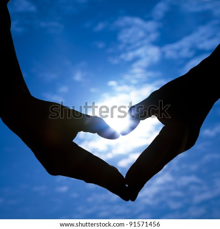 Hands making heart with sun