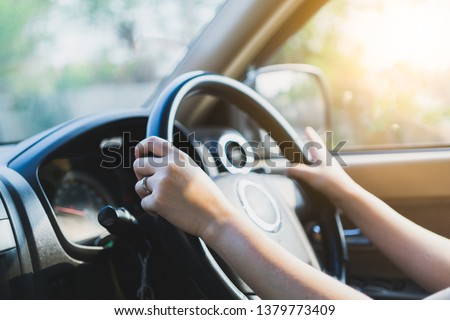 Hands male driving car. #1379773409