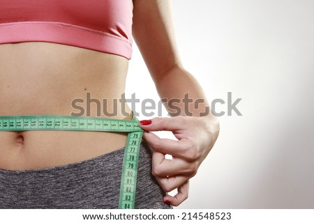 hands measuring with tape the abdomen #214548523