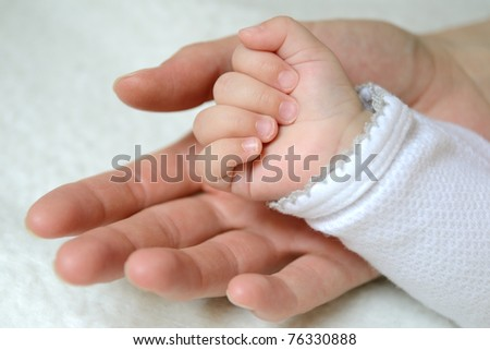 Hands - mother and baby