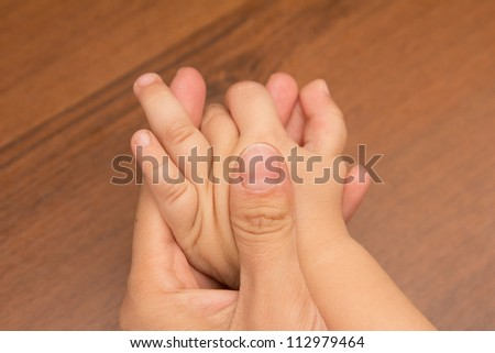 Hands mother and son