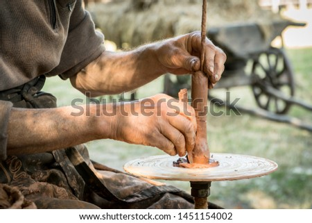 Hands of a artisan creating new clay shape from brown clay. Handicraft concept Ukraine