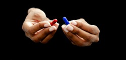 Hands of a black woman offering the red and the blue pills on a black background.  Concept of ugly truth vs beautiful lie, reality vs fiction.