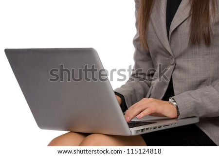 Hands of a business woman on a laptop