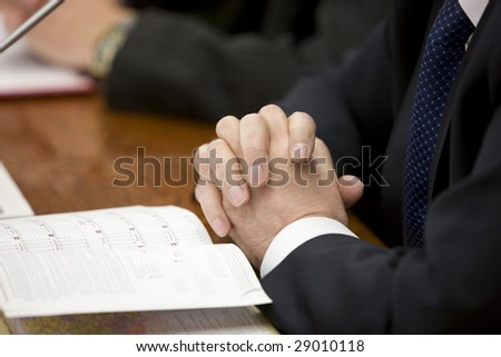 hands of a businessman lying on the table
