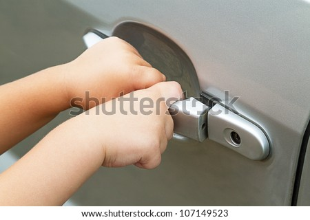Hands of a child pulling the handle vehicle - stock photo