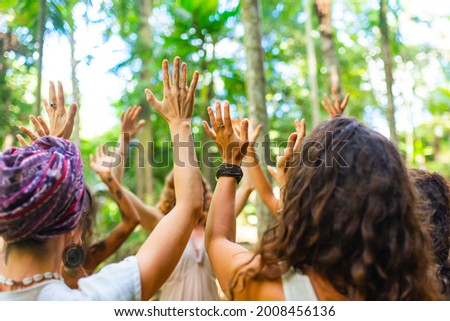 Hands of a girl dancing ecstatic dance in the forest Foto stock ©