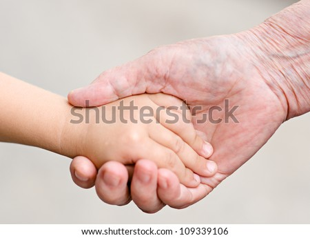 hands of a grandmother and child