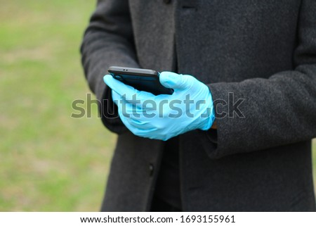 hands of a man in medical gloves for protection from COVID-19.