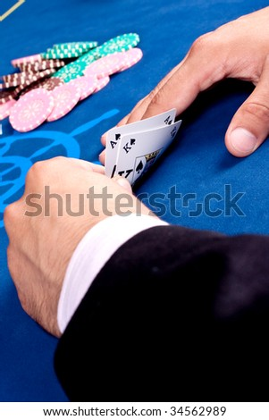 hands of a man with a card for the poker table