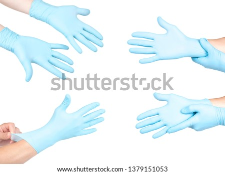 Hands of a medic in the blue latex gloves on white background