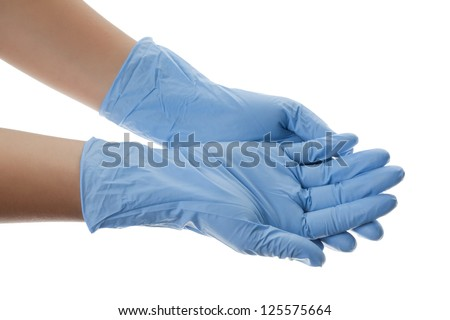 Hands of a medic wearing a blue latex gloves