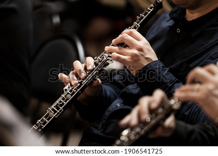 Hands of a musician playing the oboe in an orchestra Stockfoto ©