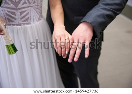 Newly-married couple on wedding dresses gold rings Images