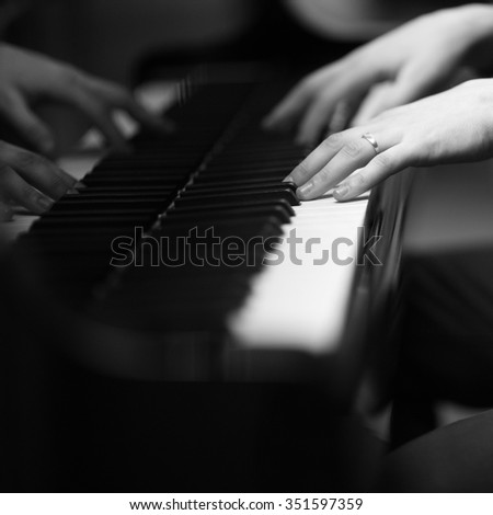 Hands of a pianist playing