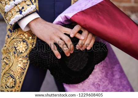 Hands of a Spanish bullfighter