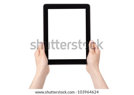 Hands of a woman holding digital tablet