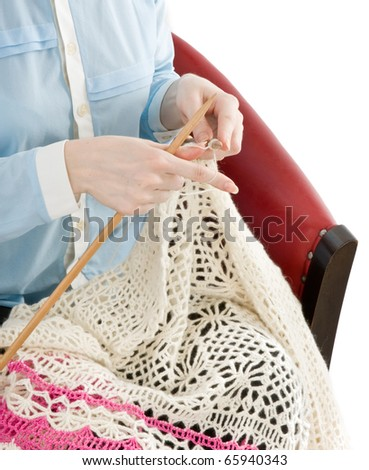 Hands of a woman knitting