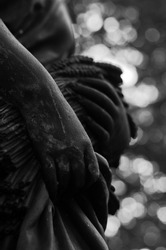 Hands of a women that reaps wheat, black and white detail from statue in Topcider park, Belgrade, Serbia