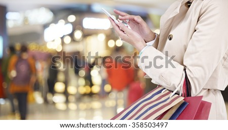 hands of a young woman using...