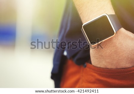 Hands of african black guy wearing trendy smart watch.Modern gadget that lets you always stay connected to internet.Smart wrist watches.Place mobile app logo on empty screen