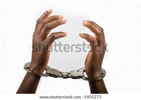 Hands of an African American woman handcuffed