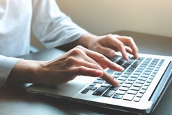 Hands of Asian woman is typing on keyboard of laptop or computer for check electronic mail, preparation of presentation in meeting, get information for shopping online or operation of internet banking