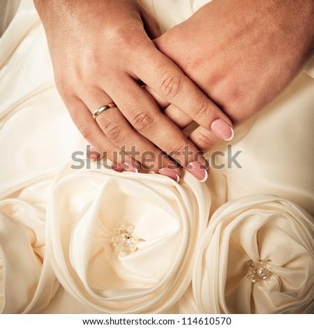 hands of bride over the dress closeup - stock photo