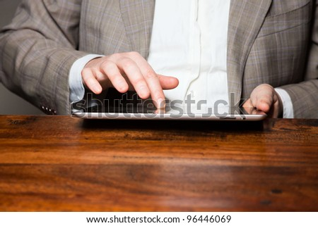 Hands of business man on tablet
