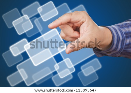 hands of business man, touching a button on blue background.