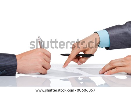 Hands of business people in elegant suits sitting at desk working in team together, with document point finger on paper sign up contract, concept, business plan. Isolated over white background
