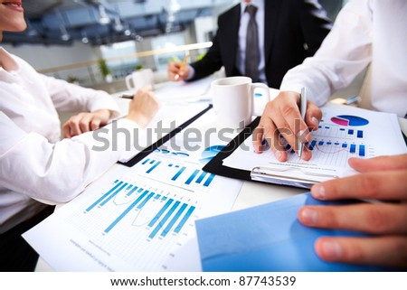 Hands of business people over documents
