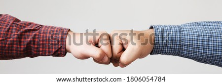 Hands of  Business people wear plaid shirt making a fist pump together after good deal. Banner panorama success and show strength power of teamwork concept. Foto stock ©
