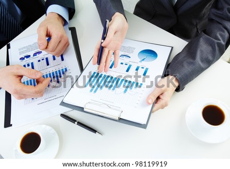Hands of business people working with documents