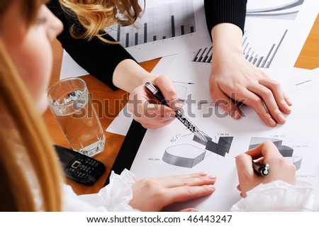 Hands of business women are actively discussing the business project. Workplace business woman.