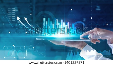 Hands of businessman analyzing sales data and economic growth graph chart on tablet and hologram screen. Business strategy and digital data, business technology, digital marketing.