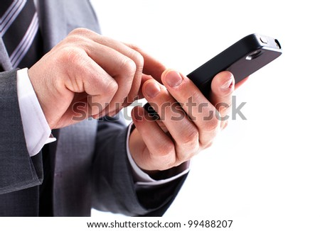 Hands of businessman calling by phone. Isolated on white background.