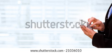 Hands of businesswoman using cellphone, copyspace on left.