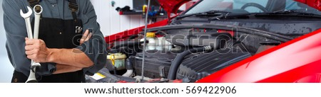 Hands of car mechanic with wrench #569422906