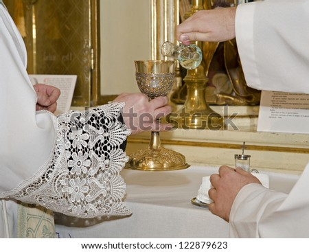 hands of catholic priest by the mass