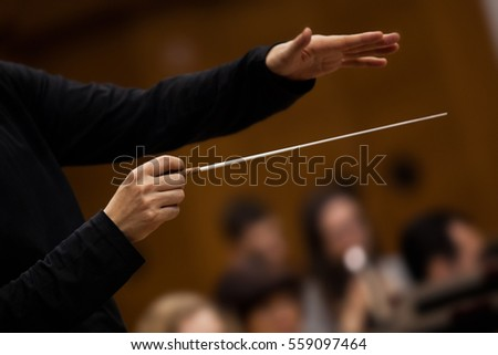hands of conductor close up in...