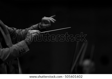 Hands of conductor in black and white #505601602