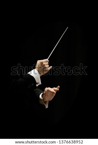Hands of conductor on a black background Foto stock ©