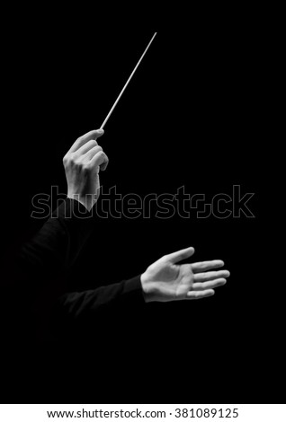 Hands of conductor on a black background in black and white #381089125