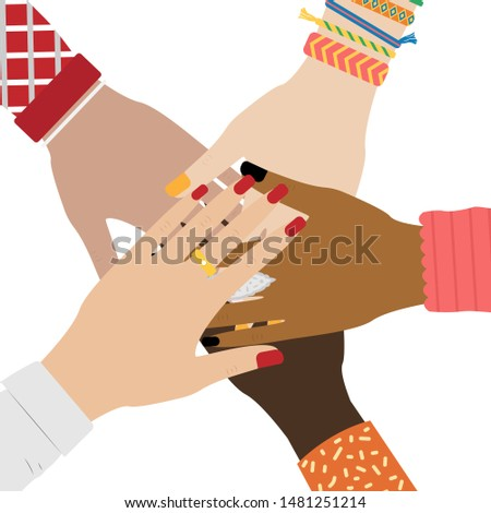 Hands of diverse group of people putting together. Concept of togetherness and teamwork. Girl hands with jewelry. White background.